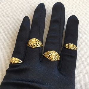 Set of four Goldtone rings